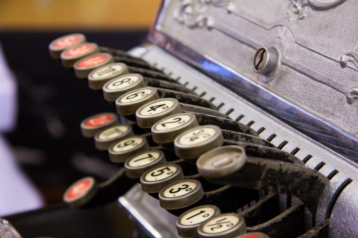 Close up of antique cash register keys.